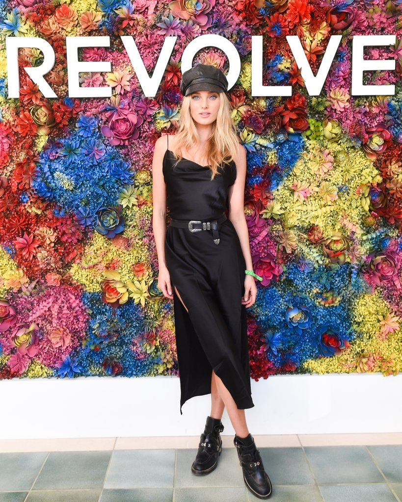 Elsa-Hosk-wearing-belted-black-slip-dress-boots-Revolve
