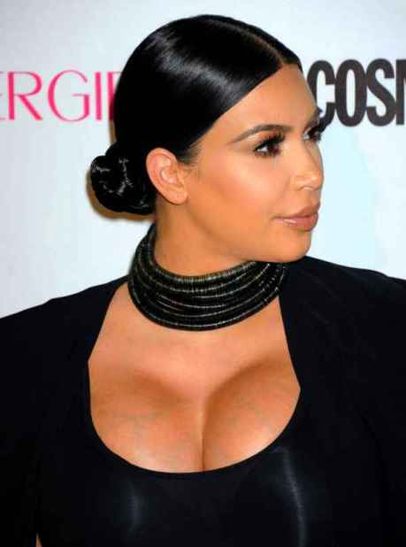 Kim-Kardashian-Low-Bun-Hairstyle-to-Wear-With-Glossy-Hair-Cream