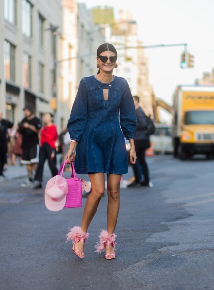 NEW YORK, NY - SEPTEMBER 10: Giovanna Engelbert wearing denim dress, pink heels and bag seen in the streets of Manhattan outside Diane von Furstenberg during New York Fashion Week on September 10, 2017 in New York City. (Photo by Christian Vierig/Getty Images)